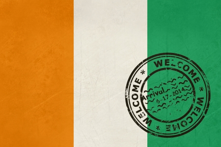 welcome to the ivory coast flag with passport stamp stock photo 23551104