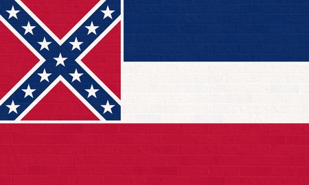 mississippi: Mississippi state flag of America on brick wall, isolated on white background.