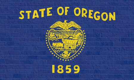 state of oregon: Oregon state flag of America on brick wall, isolated on white background.