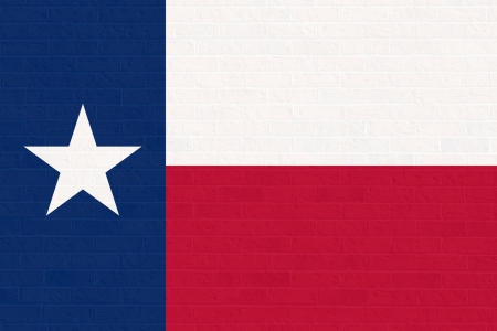 texas state flag: Texas state flag of America on brick wall, isolated on white background. Stock Photo