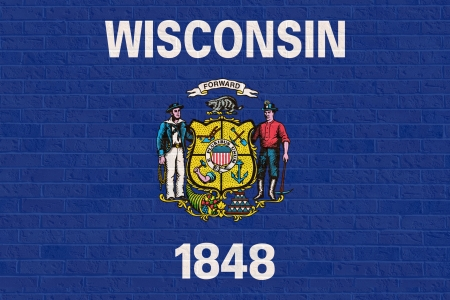 wisconsin flag: Wisconsin state flag of America on brick wall, isolated on white background.