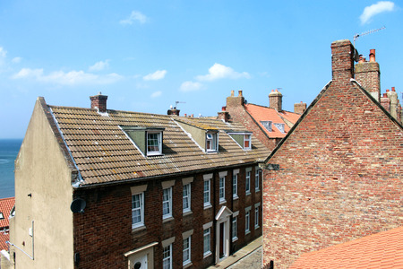 Whitby town houses over looking the sea, North Yorkshire, England. photo