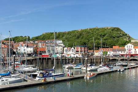 north yorkshire: SCARBOROUGH, NORTH YORKSHIRE, ENGLAND - 19th May 2014: Scarborough town and harbor seaside resort on the 19th of May 2014. This is a popular tourist destination every summer, particularly from visitors from European countries. Editorial