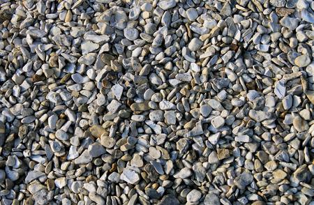 Abstract pebble or shingle background. Stock Photo