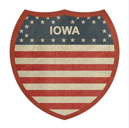 roadtrip: Grunge Iowa American interstate highway sign isolated on a white background. Stock Photo