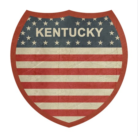 roadtrip: Grunge Kentucky American interstate highway sign isolated on a white background.