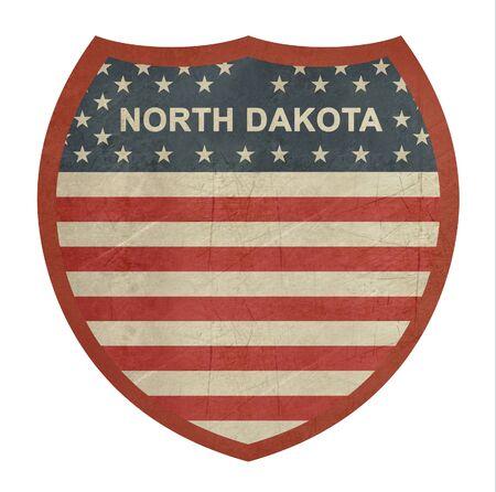 roadtrip: Grunge North Dakota American interstate highway sign isolated on a white background.