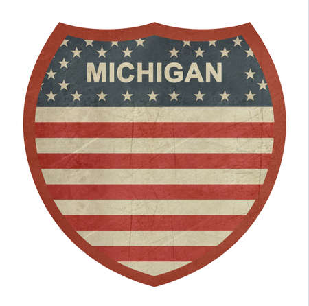 roadtrip: Grunge Michigan American interstate highway sign isolated on a white background. Stock Photo