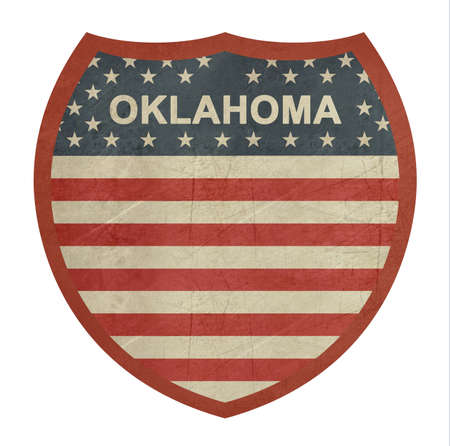 roadtrip: Grunge Oklahoma American interstate highway sign isolated on a white background. Stock Photo