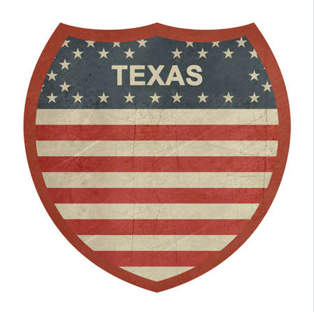 roadtrip: Grunge Texas American interstate highway sign isolated on a white background. Stock Photo