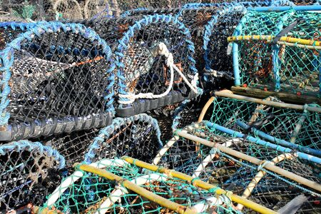 fishing industries: Stack of lobster pots and creels in Scarborough harbor.