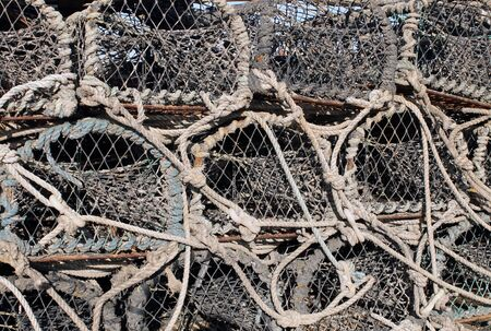 lobster pot: Background of lobster pots and creels. Stock Photo