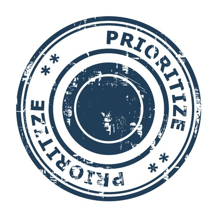 prioritize: Prioritize business concept rubber stamp isolated on a white background.