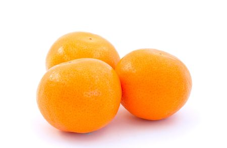 three small oranges tagerines clementines