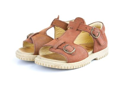 wearing sandals: A pair of baby toddlers brown open shoes Stock Photo