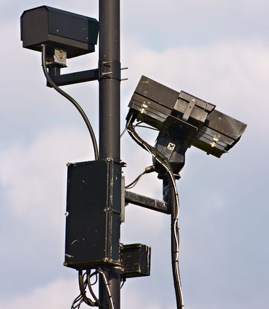CCTV security cameras watching over the community Stock Photo - 4761989