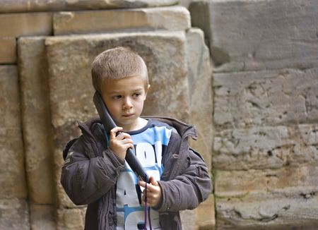 young boy listens to a commentary during an historical building visit