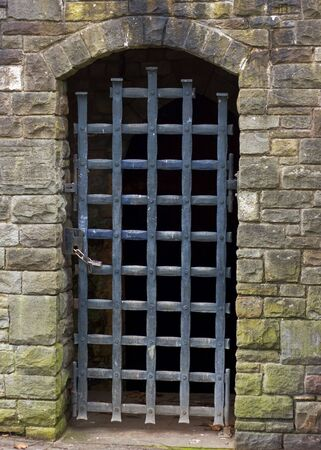 portcullis: A gated stone entrance doorway in the remains of Bristol Castle UK