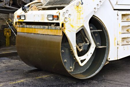 Close up of a steam road roller levelling the tarmac asphfalt