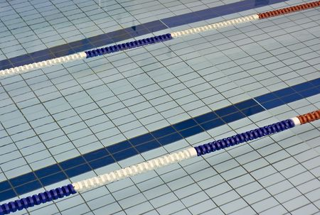 Lane markers dividers for racing in a swimming pool photo