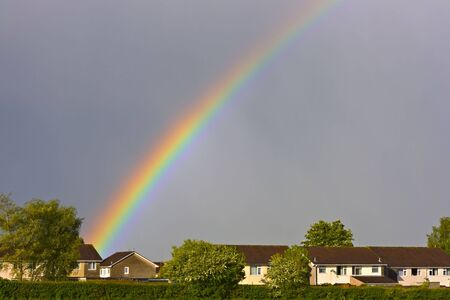 Beautiful rainbow over the rooftops