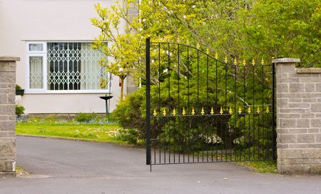 A modern house with security gates on the windows and entrance Standard-Bild