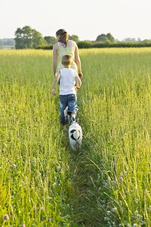 A woman and young boy out waiking the dog photo