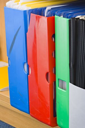 A colorful row of storage files on a shelf Stock Photo