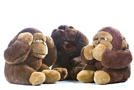 Three plush gorillas represnting the proverb of the wise monkeys Standard-Bild