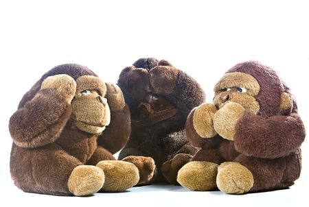 Three plush gorillas represnting the proverb of the wise monkeys Stock Photo