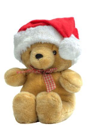 A childs teddy bear wearing a santa hat