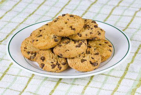 A plate of chocolate chip cookies ready for tea Stock Photo