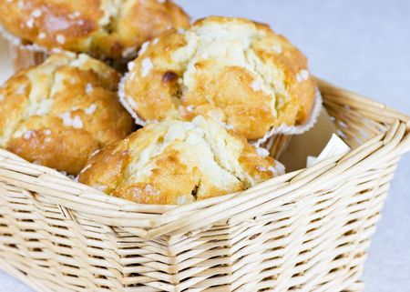 A woven wicker basket containing tasty muffins Stock Photo