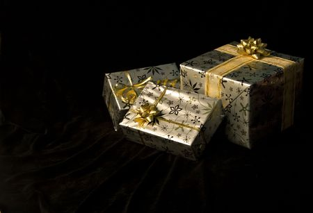 Wrapped Christmas gifts on a black background photo
