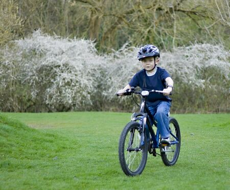 A young six year old boy riding his bke Standard-Bild