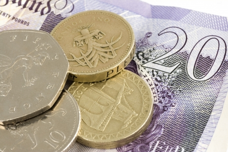 wage: Uk sterling money notes and coins Stock Photo
