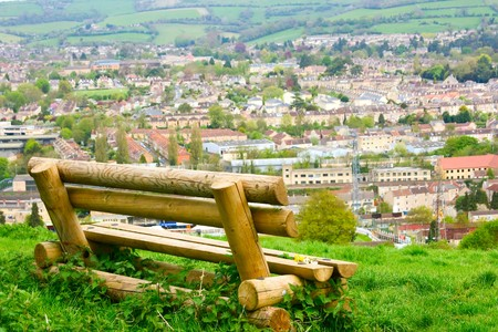 A rustic bench overlooking the city of Bath photo