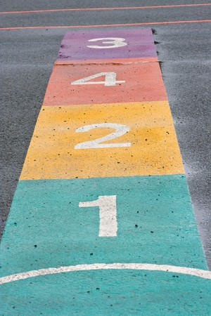 A colourful hopscotch game painted on a playground