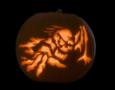 A pumpkin carved with a spooky image for halloween photo