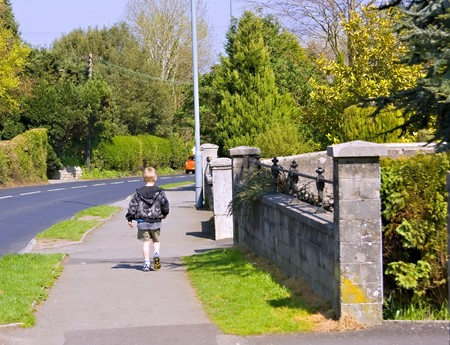 A young six year old boy walking home by himself Standard-Bild
