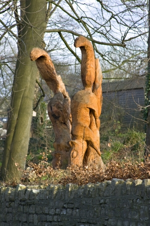 Old tree stump carved into two squirrels