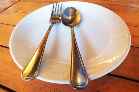 Ready to eat food with spoon , fork and dish . Stock Photo - 18511987