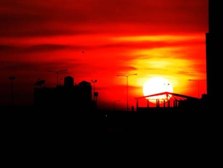 sun drop: a sun drop between two tower