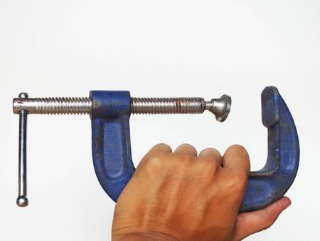 c clamp: Hand holding C clamp lock