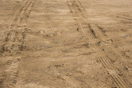 Wheel trace on the sand . photo