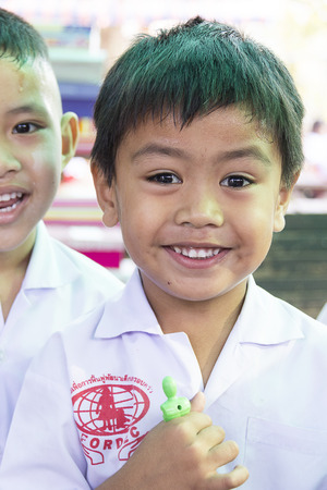 philanthropist: Mahawong - January 2 : The boys are waiting a things from philanthropist in the Childrens Day on January 2,2014 in ForDek 6 foundation Mahawong, Thailand Editorial
