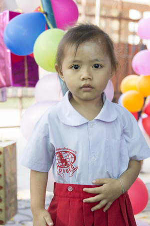 philanthropist: Mahawong - January 2 : The girl is waiting a things from philanthropist in the Childrens Day on January 2,2014 in ForDek 6 foundation Mahawong, Thailand Editorial