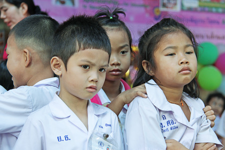 philanthropist: Mahawong - January 2 : The children are waiting some thing from philanthropist in the Childrens Day on January 2,2014 in ForDek 6 foundation Mahawong, Thailand