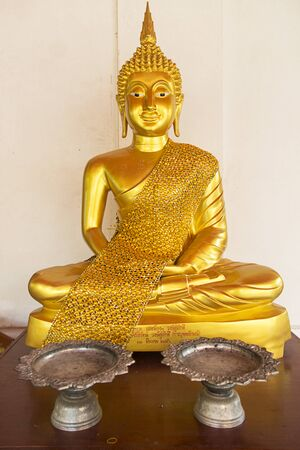 presumption: Buddha statue behind the tray in temple , Thailand