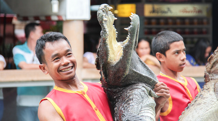 samutprakarn: SAMUTPRAKARN,THAILAND - AUGUST 2: crocodile show at crocodile farm on AUGUST 2, 2014 in Samutprakarn,Thaila nd. This exciting Editorial